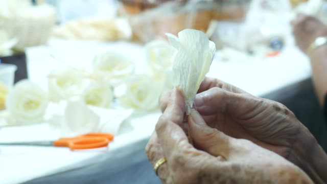 senior woman's hand sandalwood flower for laying ceremony - sandalwood stock videos & royalty-free footage