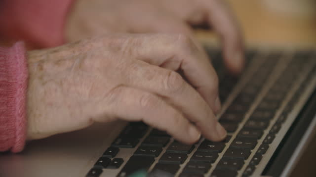 cu senior woman's hands typingon her lap top at home - keypad stock videos & royalty-free footage