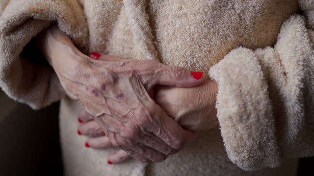 senior woman's hands - bathrobe stock videos & royalty-free footage