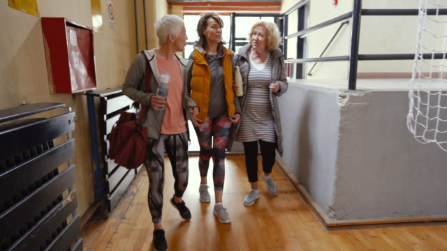 senior women arriving at dance class - baby boomer stock videos & royalty-free footage