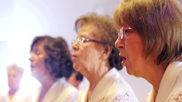 senior women at choir singing practice - choir stock videos & royalty-free footage