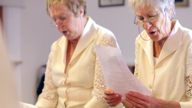 senior women at choir singing practice - sibling stock videos and b-roll footage