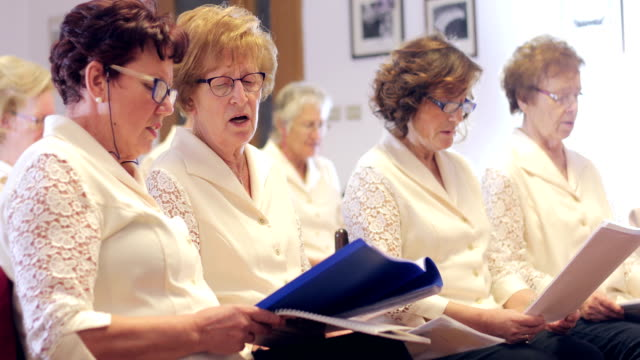 senior women at choir singing practice - choir stock videos & royalty-free footage