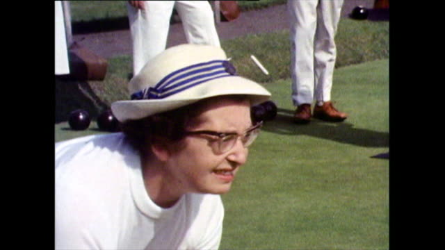 cu of senior women bowling in a game of lawn bowls; 1971 - skirt stock videos & royalty-free footage