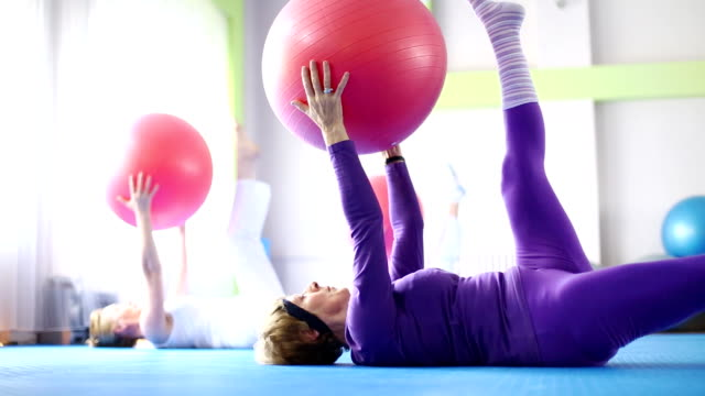 senior women doing pilates. - aerobics stock videos & royalty-free footage