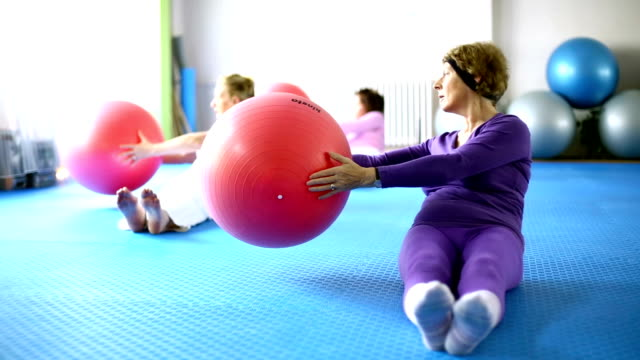 senior  women doing pilates. - flexing muscles stock videos and b-roll footage