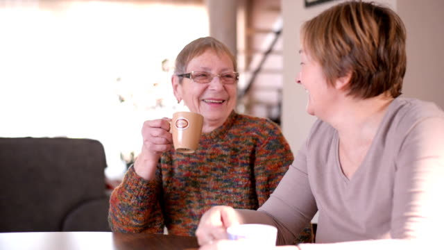 senior women drinking coffee - adult offspring stock videos and b-roll footage