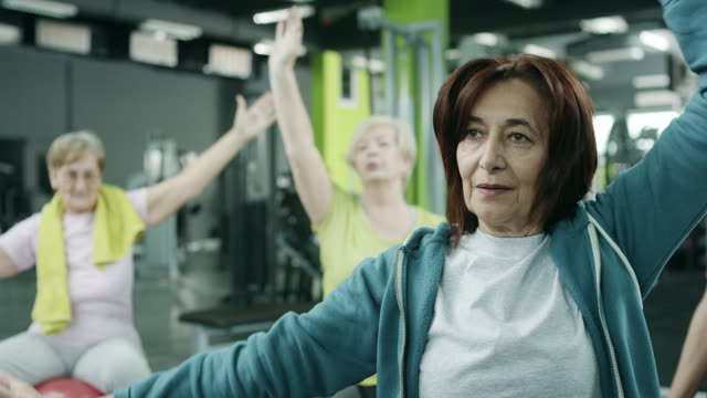 senior women exercising in gym - medium group of people stock videos & royalty-free footage