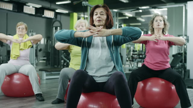 senior women exercising in gym - pilates stock videos and b-roll footage