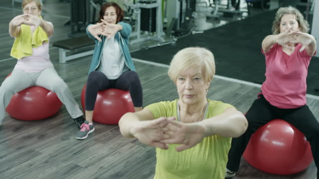 senior women exercising in gym - exercise class stock videos & royalty-free footage