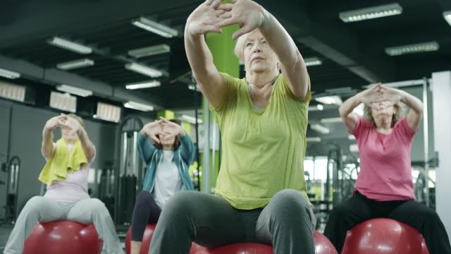 Senior women exercising in gym