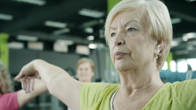 senior women exercising - routine stock videos and b-roll footage