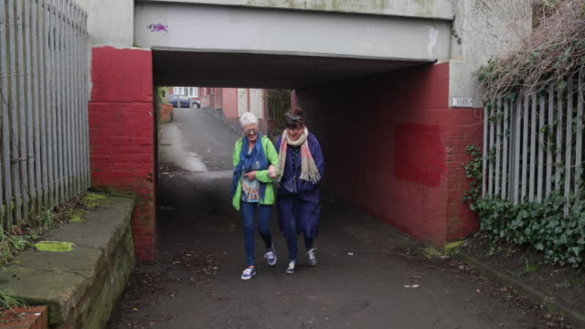 senior women going for a walk - underpass stock videos & royalty-free footage