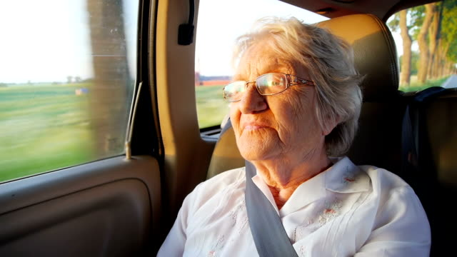 senior women in the car at sunset - passenger stock videos & royalty-free footage