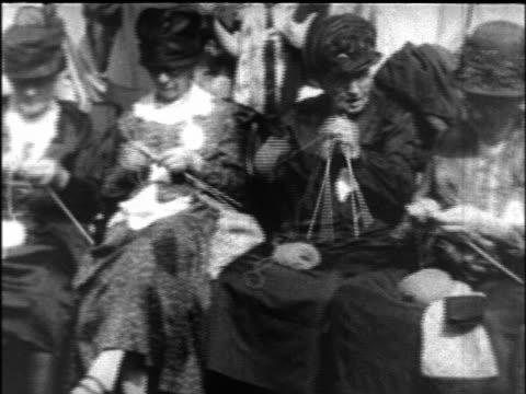 B/W 1927 PAN senior women knitting at Elderly Convention / newsreel
