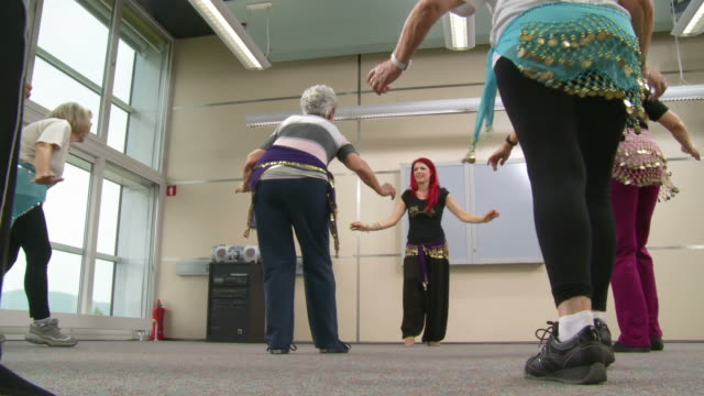 hd: senior women learning belly dance - recreational pursuit stock videos & royalty-free footage