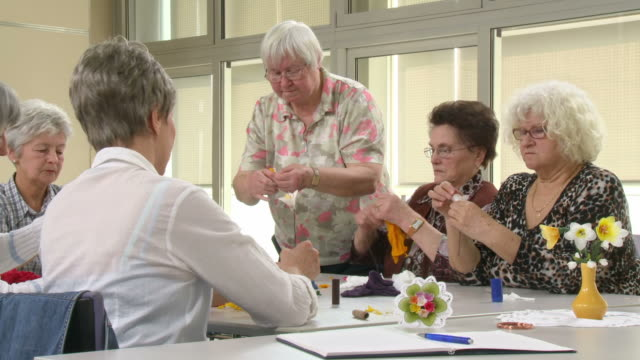 HD DOLLY: Senior Women Making Flower Decorations