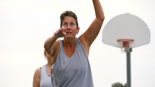 ms senior women practicing free throws on outdoor basketball court before game - drive ball sports stock videos & royalty-free footage