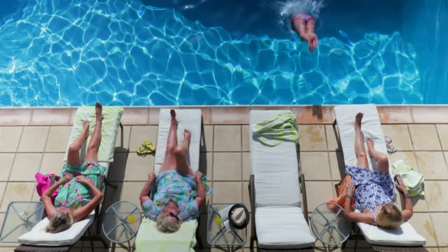 senior women relaxing on holiday - sunbathing stock videos & royalty-free footage
