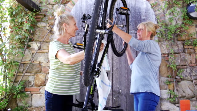 Senior Women Repairing a Bicycle