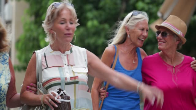 senior women shopping - young at heart stock videos & royalty-free footage