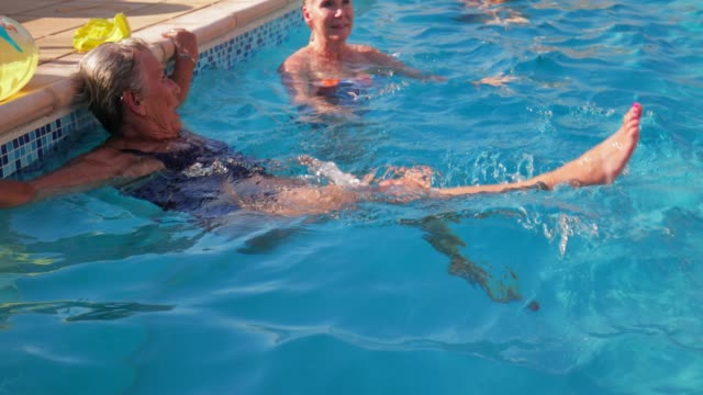 senior women talking in the swimming pool - poolside stock videos & royalty-free footage