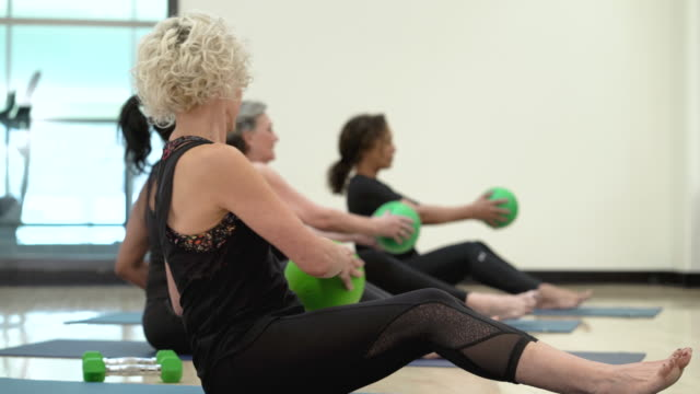 Senior women using medicine balls