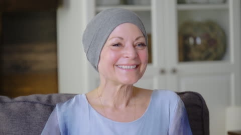 a senior women with cancer is sitting on the couch. - positive emotion stock videos & royalty-free footage