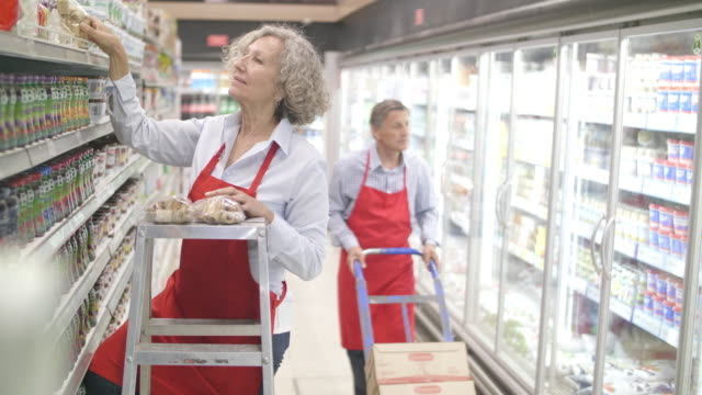 senior workers of a supermarket - arranging stock videos & royalty-free footage