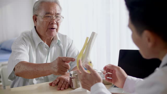 seniorman visit doctor for treatment with bone and joint symptoms - achilles tendon stock videos & royalty-free footage
