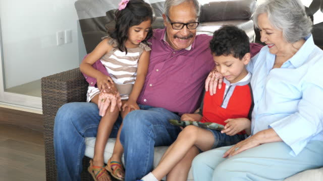 seniors and grandchildren in latino multi-generation family. - mexican ethnicity stock videos & royalty-free footage