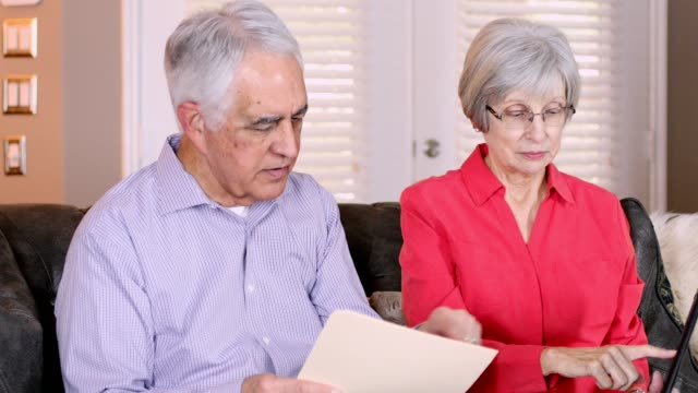 Seniors at Home paying bills