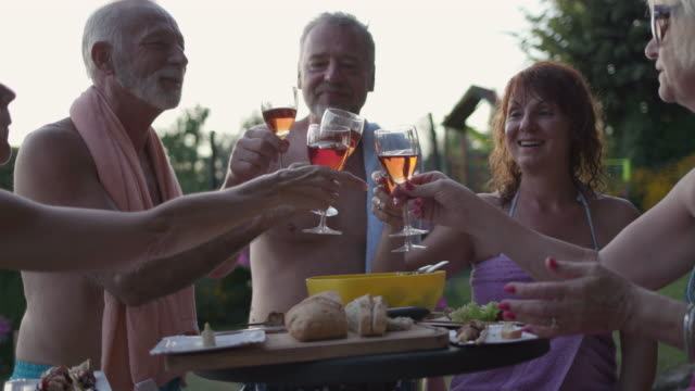 seniors bbq party by the pool - villa stock videos & royalty-free footage