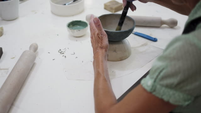 seniors ceramics classes - potter stock videos and b-roll footage