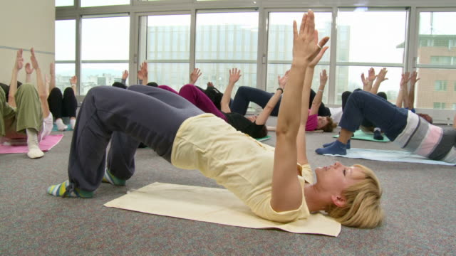 hd dolly: seniors doing pilates exercises - pilates stock videos and b-roll footage