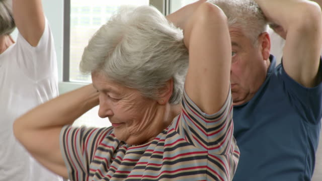 hd: seniors doing stretching exercises - community center stock videos and b-roll footage