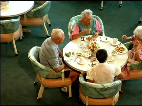 stockvideo's en b-roll-footage met seniors eating in restaurant - dining room