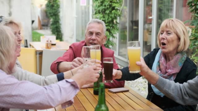 seniors enjoying artisanal food and drink at outdoor cafe - artisanal food and drink stock videos & royalty-free footage