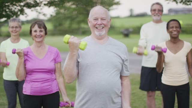seniors exercising outdoors - weights stock videos and b-roll footage