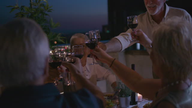 seniors having dinner on rooftop - patio stock videos & royalty-free footage