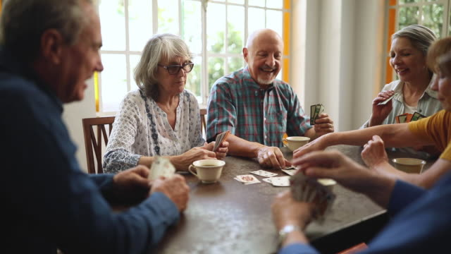 seniors having fun playing cards in nursing home - playing card stock videos & royalty-free footage