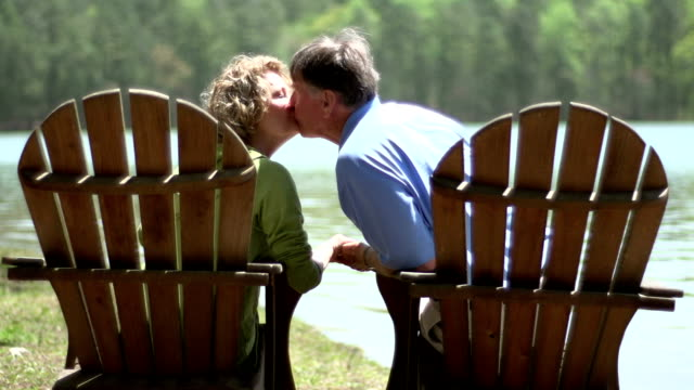 seniors kissing - adirondack chair stock videos & royalty-free footage