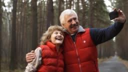 Seniors Making Selfie in Woods