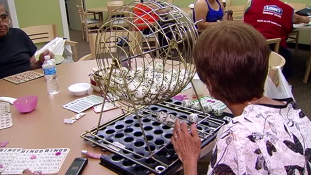 stockvideo's en b-roll-footage met seniors playing bingo in cooling center on july 18 2013 in chicago illinois - bingo