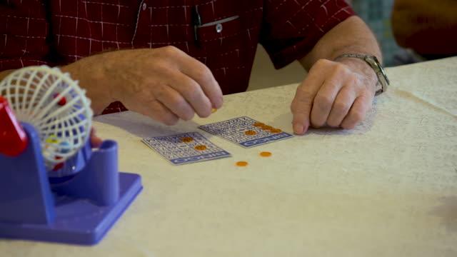 seniors playing bingo - gambling stock videos & royalty-free footage