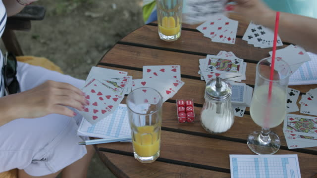 Seniors playing cards, handheld shot