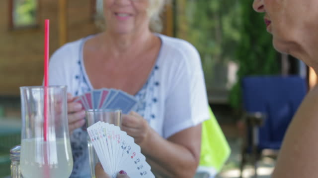 seniors playing cards, handheld shot - cards stock videos and b-roll footage
