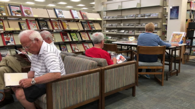 seniors reading at library - library stock videos & royalty-free footage