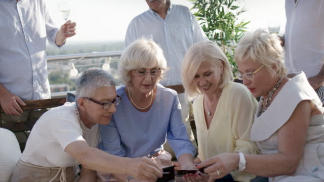seniors rooftop party - grey hair stock videos & royalty-free footage