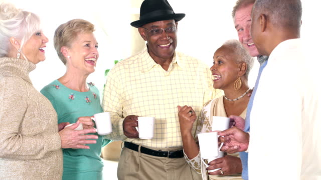 seniors socializing, talking over coffee - 60 69 years stock videos & royalty-free footage